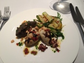 Provencal stuffed squid with aubergine caviar, chilli and anchovy dressing, courgette salad and salted almond