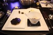 La Truffe Noire du Périgord Light gruyere soufflé, black truffle coulis; Crispy black truffle tart with confit onion; Foie gras ravioli in chicken broth with fresh herbs and spiced cream