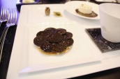 Crispy black truffle tart with confit onion