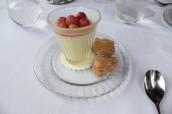 Lemon and elderflower posset with pink gooseberry compote and beignet