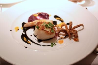 """Seared scallop, purple potato """"risotto"""", squid ink sauce & crispy squid"""