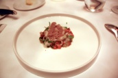 Veal head & tongue with aromatic vegetables & capers in sauce poulette