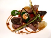 Slow Cooked Saddle of Herdwick Lamb with Jersey Royals, New Season's Morels, Wild Garlic and Roasting Juices