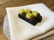 Homemade black pudding, pineapple and burnt pineapple puree