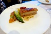 Crispy pork belly, tomato salsa, black olive, braised baby gem