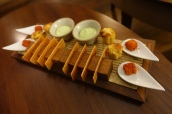 Canapés - Parmesan custard with chorizo powder, Corn & bacon muffin, Lovage cream and savoury tuiles